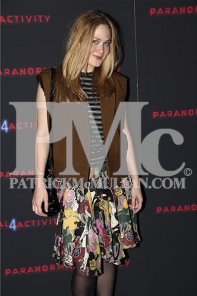 Louisa Krause in Radenroro outfit jacket skirt ballerina top vest at Paranormal Activity 4 premiere in New York